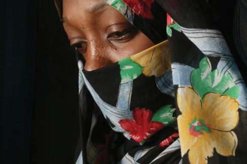 Halima, hidden behind a pseudonym and a veil